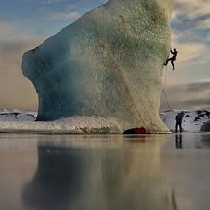 Photo by @renan_ozturk // We dubbed this fozen iceburg playground the 'windy lagoon' since on most visits it was blowing so hard you could fully fall into the wind and get pushed back the other direction.  While trying to make it out to this iceberg the conditions were too warm and at first @pfaff_anna fell in to her waist in the slushy ice water.