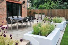 Urban Garden Design contemporary block planters filled with grasses and allium