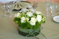 centerpieces--i like the greenery...