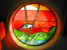 Stained glass window salvaged from a bar in St. Paul, Minnesota sits at the base of the stairs  at our cabin, Oma Tupa, Oma Lupa