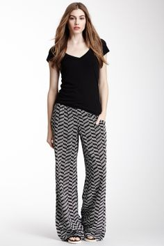 "Herringbone Print Palazzo Pant black combo by Bobeau $48 - $24 @HauteLook. - Elasticized waist - 2 front slant pockets - Wide leg - Allover herringbone print - Approx. 10.5"" rise, 32"" inseam Model's stats: - Height: 5'8"" - Bust: 34"" - Waist: 25"" - Hips: 35"" Model is wearing size S. Machine wash. 100% rayon."