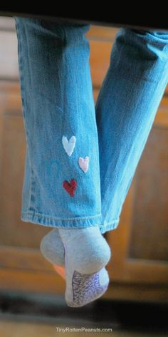 How to embroider little secret hearts onto jeans. From Tiny Rotten Peanuts