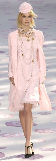 Chanel.  A demo how to wear pearl jewelry