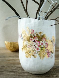it even comes with a tutorial (if you don't mind translating French). Aline Caron of My Little Fabric covered raw papier maché with white paint and Japanese cherry blossoms that she cut from patterned paper and decoupaged on glowing gold leaf.
