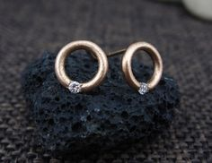 Solid 14K rose gold handmade earrings in minimalist and dainty style.  Each solid gold earring has one set Conflict Free diamond. Diamonds clarity is