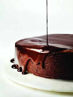 The plummy-berry notes of red wine are highlighted when mixed with chocolate and butter into a glaze that drips over the edges of this decadent Darkest Chocolate Cake with Red Wine Glaze. #shockinglydelicious #chocolatecake #cookingwithwine #chocolate