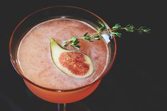 Fig & Thyme cocktail      1 1/2 oz pisco     1/4 oz Cointreau     1/2 oz thyme simple syrup     1/2 oz lime juice     1 fig (quartered)     sprig of thyme + halved fig