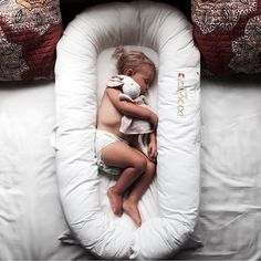 This adorable girl is using the Grand DockATot to transition into her own bed from the crib. So far it's working! DockATot helps toddlers ease from crib to bed with the help of uniquely shaped bumpers. Visit dockatot.com for more info on this must-have baby gear.