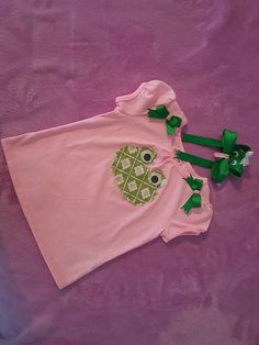 Check out this item in my Etsy shop https://www.etsy.com/listing/273230692/frog-t-shirt-with-hair-bow