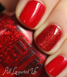 Glossy red with sparkly red accent nail