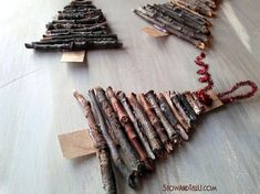 Twig Christmas Tree Ornaments - Using twigs and a strip of cardboard these twig Christmas tree ornaments were pretty easy to make. We made them in mass quantit…