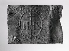 #english #object dating unnknown Pilgrim-badge; lead alloy; rectangular plate stamped with sacred monogram cross and three nails within an oval panel with rayed border; anchor; inscribed.