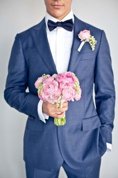 Blue suit would be beautiful with yellow and pink as wedding colors