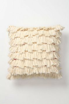 Fiber Art Pillow -  I love texture with pillows but I don't like spending $60 dollars for it. This seems very easy to replicate myself for very little and customize it to any interior. If I ever make it I'll be sure to post pics of what mine looks like :}