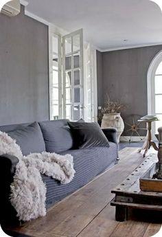 grey walls. wood flooring.