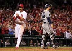 Matt Carpenter celebrates as he scores the tying run on a bases-loaded walk by Matt Adams in a game against the Brewers... eighth inning. Cards won 3-2. 9-18-14