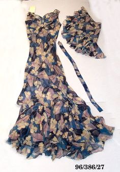 Evening dress in silk chiffon printed with stylised flowers and leaves in midnight blue, light blue, mauve and white; skirt bias cut with diamond godets flaming into a wide hem. Evening Dresses, Summer Dresses, Silk Chiffon, Midnight Blue, Mauve, Light Blue, Leaves, Australia, Marketing