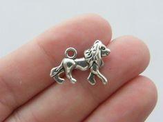 8 Lion charms antique silver tone A39