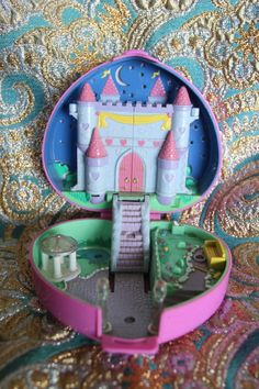 I'll never forget this Polly pocket I had! I got her jammed under the stairs at least once a week! Haha