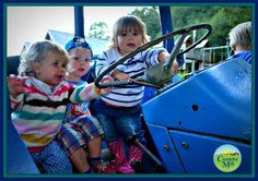 Toddlers on the play tractor at Coombe Mill Family Farm Holidays, Cornwall http://www.coombemill.com/blog/post/2014/09/13/Silent-Sunday-Project-5218
