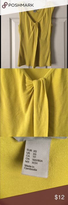 """H&M top in mustard Downsizing my closet!! size:XS Bust: 14.2""""/36cm Length: 22.5""""/57cm Approximately  In great condition. H&M Tops Tank Tops"""