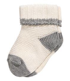 Natural white. Knit socks in a soft cotton-blend with a ribbed cuff at top and contrasting details.