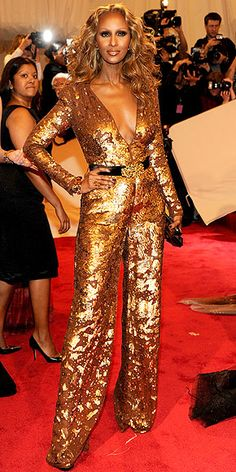 Living legend Iman in a gold Stella McCartney jumpsuit