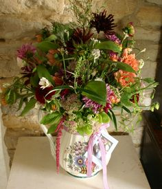 A congratulations on your new home arrangement, all British cut flowers at www.commonfarmflowers.com
