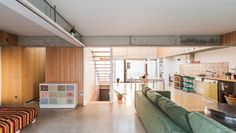 <p>Casa Migdia in Granollers, Spain is a house envisioned by SAU Taller D'Arquitectura. Working with the maximum of natural light, the architects aimed to construct plenty of communal spaces in the at