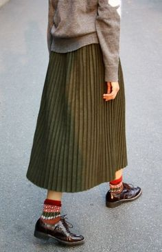 Green pleated midi skirt worn with brown brogues, knitted argyle socks and light brown jumper