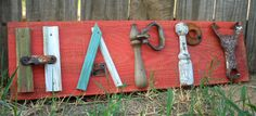 "Would love to recreate this with ""Family"".  Rustic ""HAPPY"" red sign on old wood made with everyday junk.. $35.00, via Etsy."