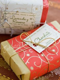 brown paper with band of designed paper label and ribbon