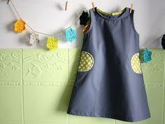 Robe trapèze avec poches passepoilées en demi-cercle - lien vers tuto inside