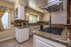 Country Kitchen with Flush, Complex granite counters, Kitchen peninsula, limestone tile floors, Complex Granite, flush light