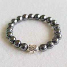 Hematite stretch bracelet with Buddha charm
