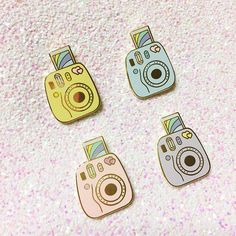 For all you Fuji fans out there, a way to capture beauty every day. Pin by Daily Gems. Approx. 1 inch. Hard enamel with gold finish. Available in pink, blue, lavender, and yellow.