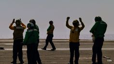 So many signals on the flight deck on the USS Carl Vinson CVN-70