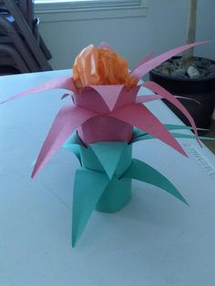 The Bromeliad Flower found in the Rainforest [used toilet paper roll, wrapped in 4 layers of construction paper pre-cut like this: /\/\/\/\ red, 2 green) Then peel back for points and stuff top with orange or yellow tissue paper] Rainforest Flowers, Rainforest Crafts, Rainforest Biome, Rainforest Activities, Rainforest Animals, Craft Activities, Rainforest Classroom, Preschool Jungle, Jungle Crafts