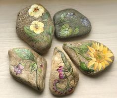 Stone with a hand-painted pink flowers by SkadiaArt on Etsy