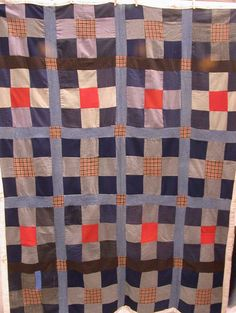 Vintage quilt:  made from old coats and backed with curtain material.  Strong graphic design.