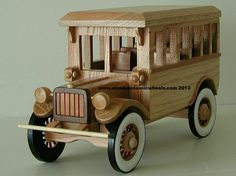 """1917 Crown School Bus:   what a bang,  this is the perfect gift to award / acknowledge an outstanding performance by an employee or an associate.  then recognize a job well done by having it engraved with a special message or your school name. best promotional and marketing gifts .  Built from: solid hard maple, painted black spoke wheels  Approx. size 12"""" Long X 10"""" Tall X 8"""" Wide"""