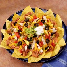 Crispy corn tortilla chips smothered with beans, chicken and cheese and topped with tomatoes, green onions and ripe olives.
