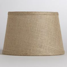 Natural Burlap Accent Lamp Shade - World Market by Cost Plus World Market. $12.99. Soft light filters through our Natural Burlap Accent Lamp Shade, casting a warm glow on your space. This eco-chic shade is made from 100% burlap, a wonderfully versatile material that offers a rustic look.
