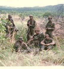 These men have been in action and are in no mood to smile for the camera. Military Deployment, Military Life, Military History, Psychological Warfare, Defence Force, Kendo, Ol Days, Special Forces