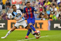 Barcelona's French defender Jeremy Mathieu (L) vies with Deportivo's Romanian forward Florin Andone during the Spanish league football match FC Barcelona vs RC Deportivo de la Coruna at the Camp Nou stadium in Barcelona on October 15, 2016 / AFP / LLUIS GENE