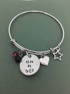 Be the star of the show with this adjustable bracelet complete hand-stamped, 2-sided charm, star charm, heart charm, and purple & magenta Swarovski crystals. Bracelet is adjustable. There are two choices for size. The medium size is 8 inches in diameter and stretches to 8 3/4 inches. The