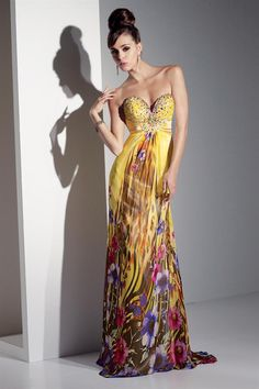 Dramatic chiffon print sweetheart long prom gown with matching mixed beads on the bustline. Empire waistline with large crystal appliqué at the center. A-line flowing skirt with sweep train. Long Prom Gowns, Strapless Dress Formal, Prom Dresses, Formal Dresses, Chiffon Dress, Dress Skirt, Prom Girl, Designer Gowns, Mellow Yellow