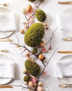"""Give soft green moss an extra-festive update by shaping it into elegant eggs. Arranged with quince branches and blown-out eggs, this collection is a natural Easter centerpiece. See the """"Moss-Egg Centerpiece"""" in our gallery Easter Table, Easter Eggs, Diy Ostern, Deco Floral, Easter Brunch, Easter Dinner, Easter Party, Easter Gift, Decoration Table"""