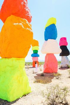 Rainbow colors in the desert // seven magic mountains // outside las vegas, nevada // colored stacked rocks pop art