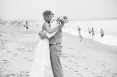 Carlsbad CA beach wedding bride and groom first look embrace